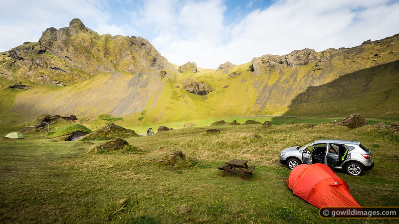 Vestmannæyjar campground, sited in an old volcanic crater. The location is fairly sheltered and there are some short, exposed, hikes on the ridge above.