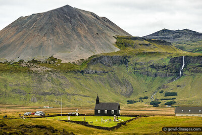 Buðakirkja, a modern recreation of the original church which was completed in 1848. Mælifell peak beyond.