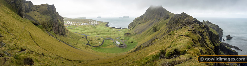 Vestmannæyjar campground and golf course from the rim of the crater.  This panorama can be printed up to 86cm wide at photo quality, or larger as a poster.