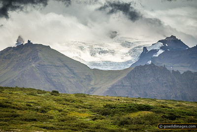 Walkers enjoy the glacial view of Vatnajökull National Park, above Skaftafell