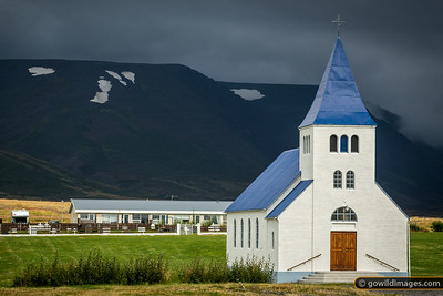 A rare blue church, Hofsóskirkja, in the small town of Hofsós. The area is known for its scenic pool.