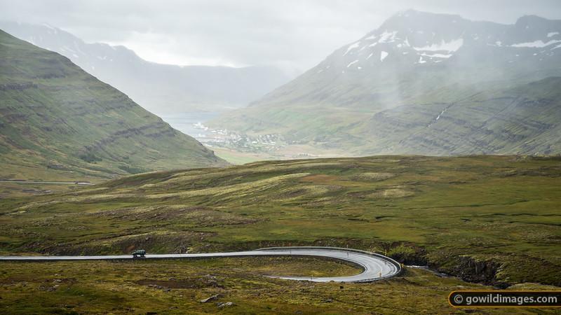 Road 93 winds down into the sheltered Seyðisfjörður port