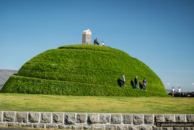 A turf mound adorned with a fish-drying hut gives a relaxing view of Reykjavik's harbour activities