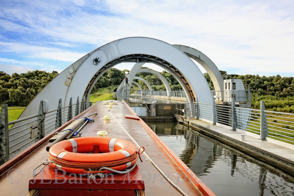 Approaching the Canal 2010-10-14  Another view of the Falkirk Wheel in Scotland.  That's our narrowboat, just about finished rotating to match the runway to the Union Canal.  It is very quiet, and the caisson holding the boat stays wonderfully flat and smooth during the 15 minute trip up (thank heavens!) - and it is so well balanced that it only takes a few hundred watts to move this giant wheel.  I'll get back to commenting and more posting tomorrow!  Enjoy the day.