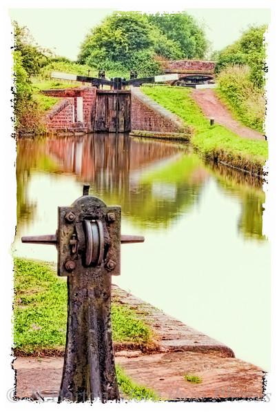 Starting Tardebigge Locks 29, 30 and beyond the bridge 31 near Bromsgrove, Worcestershire