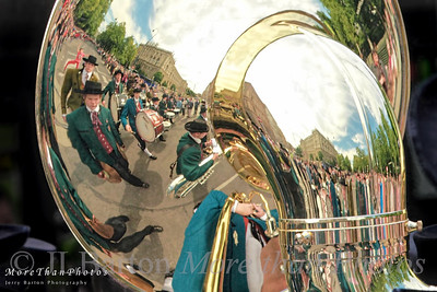 A Parade in One Picture 26 traditional Austrian marching bands performed and marched along Vienna's Ring last Saturday.  Here you have spectators, band, traditional uniforms, classic buildings all together.  For more impressions from the parade, take a look at my Vienna gallery: http://www.jerrybarton.eu/Landscapes/Vienna