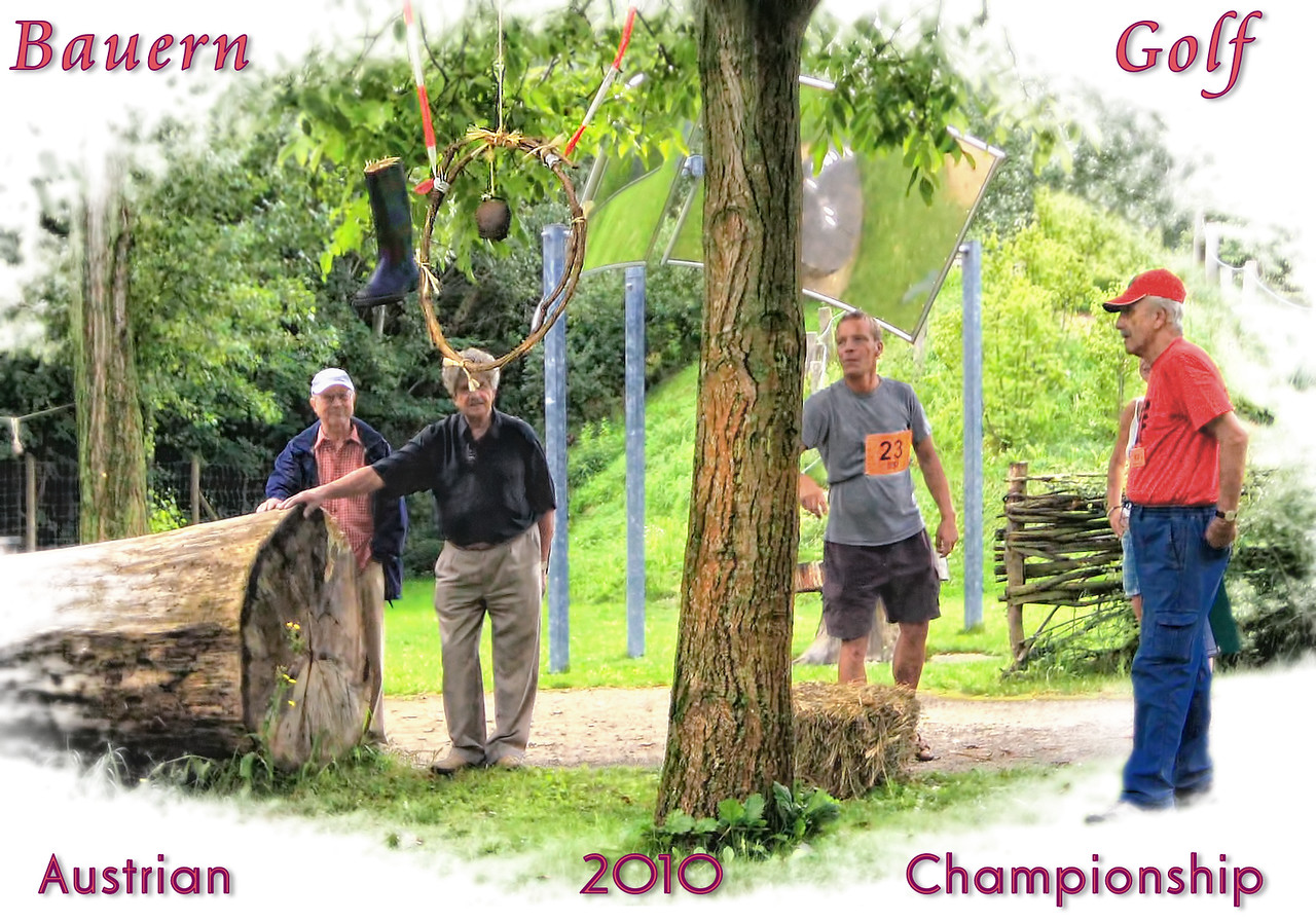 """""""Farmers' Golf"""" 2010-08-16:  This rural form of 'golf' is played with boots instead of balls, with various 'holes'.  There are 21 such holes.  You stand behind the hay and throw various sized boots.  This is hole 4.  Four points for throwing the boot through the loop without touching the loop.  An extra point if it doesn't touch the bell.  Number 23 has trained hard and managed this shot and many of the others perfectly.  The championship matches were held in Vienna this year.  This shot has been manipulated of course - vignette and text added.  Thanks for the amazing number of comments on my really yucky slug picture.  You are a wonderful group of people.  Off to another busy day.  Enjoy Monday."""