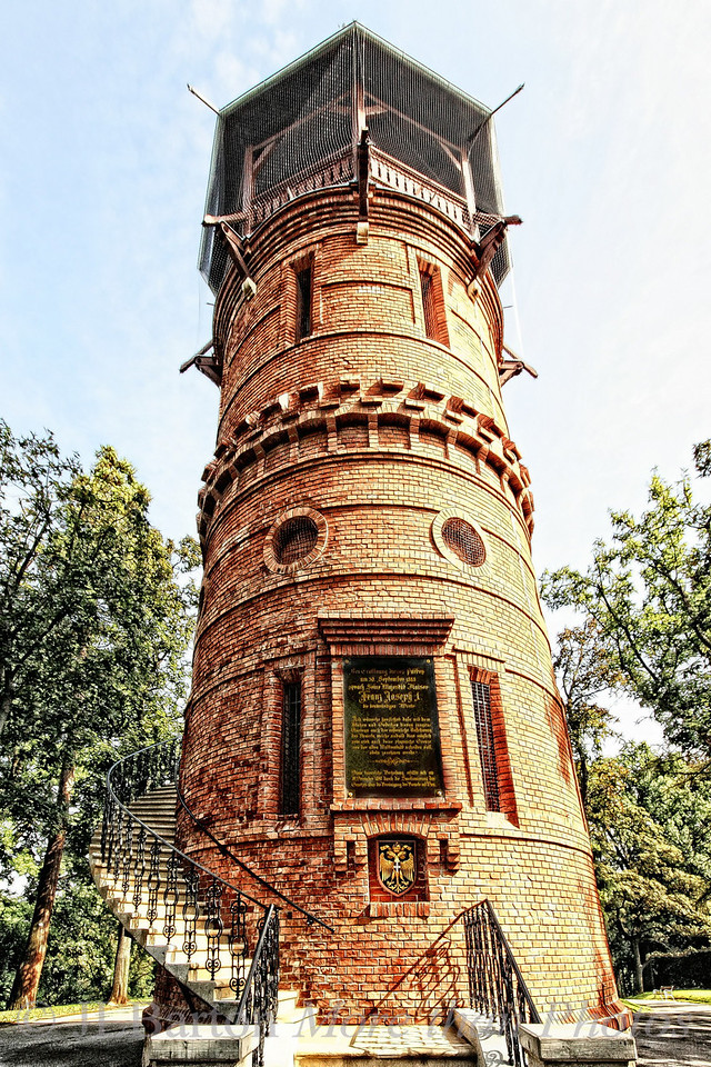 Pauline's Tower Dedicated to the memory of Pauline Metternich who helped fund much of the park, the Paulinenwarte in the Türkenschanzpark in Vienna's 18th district was recently renovated and re-opened to the public.  It stands 23 m. above the park, and carries a dedication by the Emperor from 1888 hoping that the then suburbs would become part of Vienna - which they did.  This picture is what I call my 'para-sketch' style - I've added a sketch layer blended with the original to emphasize the lines, and the colors are slightly bleached.  This is the last of the pictures from the park - for the time being :->  Thanks again for all the comments on my pictures over the last three days.