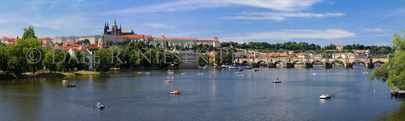Prague Castle and the Charles Bridge over the Vltava River in the Czech Republic.