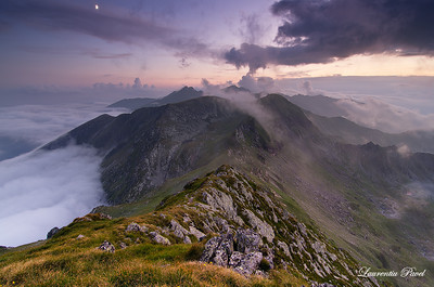 Dancing with the clouds  Negoiu and Caltun peaks in the background viewed from Iezerul Caprei at sunset Fagaras mountains