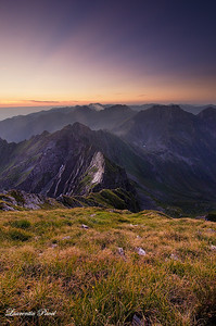 Sunrise viewed from Buteanu peak(2507m) towards Vartopel-Arpasel ridge Fagaras mountains