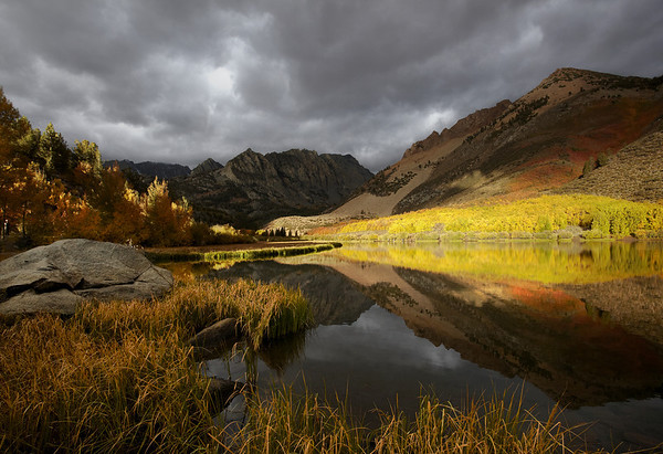 This image was taken about an hour after an Epic Sunrise...The clouds helped create dramatic light on the mountains and Aspens.