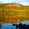 The late afternoon sun lights up the bluff at Parks Pond, Clifton Maine.