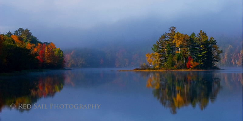 An early foggy morning shot of an island on Long Pond.