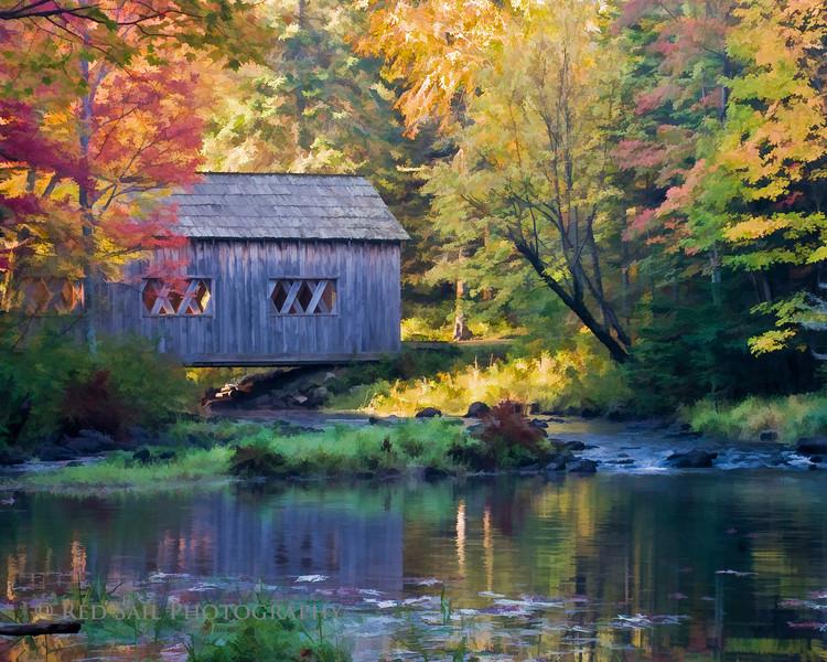 Fall in Maine. Covered bridge at Leonards Mills.
