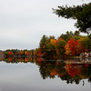 I was running late this day, but just HAD to pull over to capture this scene.  I wish I had more time to frame it better.  The leaves from the tree in the upper right hand corner bug me...but figured the reflection and color of the tree's across the lake made it worth sharing:)