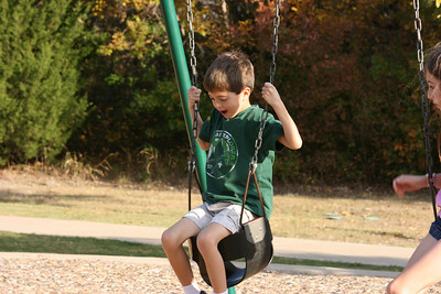 Kevin playing on the baby swing.