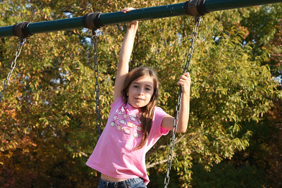 Katie playing on the swings.