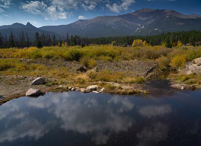 Reflecing clouds and Longs peak in fall