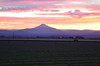 A colorful sunset over Mt Jefferson overlooking farms