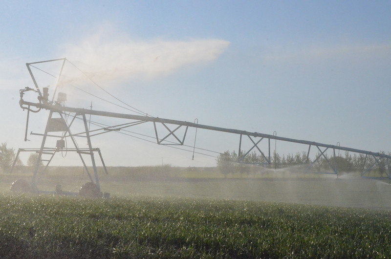 A farmers irrigation pivot line. This move automatically on a timer in a circle and once on an airplane people were all excited looking at the crop circles and I laughed because they were from  pivot lines. These cut down a lot of time spent irrigating for farmers.