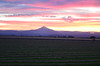 A colorful sunset over Mt Jefferson overlooking a farm