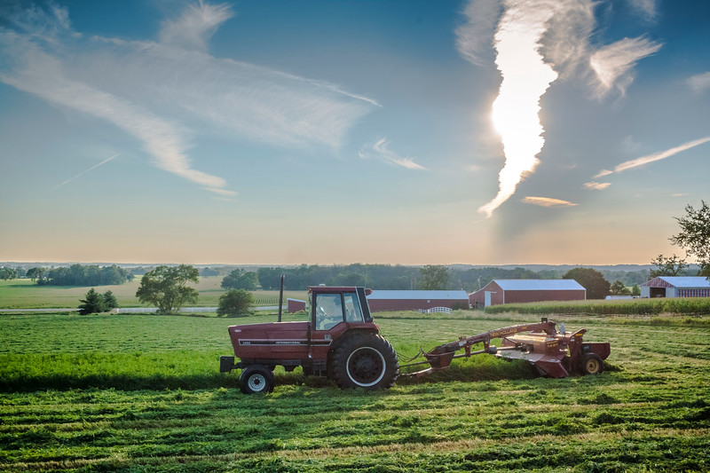 Mowing hay under jet contrails 2017.