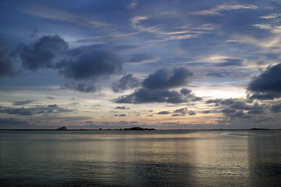 Watercolor sky and the glassy bay below