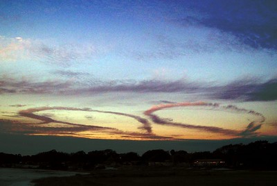 Two jet entrails, the landing pattern at Tyndall caught in the sunset