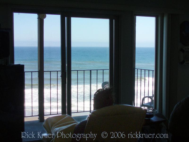 Rick with wake-up hair sitting in his favorite chair as we sit and watch the ocean surf.<br /> <br /> P7150398-RickChairWatchingOcean-2 copy.jpg