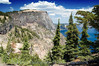 View of Crater Lake and Llao Rock on the west side of the lake from Merriam Point. Taken at the summit of the great trail we found. Looking toward the north in this photo. Absolutely beautiful location!<br /> ND70_2006-07-26DSC_5988-CraterLakeLlaoRockTrees-nice-2 copy.jpg