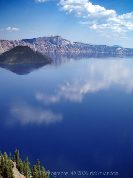 Eileen's photo of the clear lake and cloud reflections of Crater Lake, looking toward the north-northwest. Taken from the Sinnot Memorial Outlook.<br /> <br /> P7260532-CraterLakeCloudReflectionsFromSinnottMemorialOutlook-2 copy.jpg