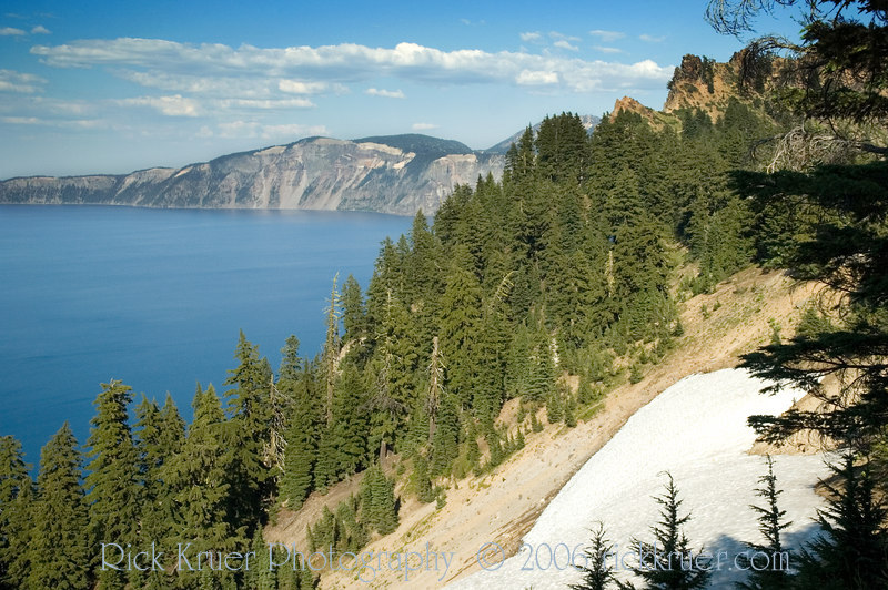 The snow is everywhere at Crater Lake, OR. We were amazed that much of Crater Lake was still closed for the winter only a few weeks before our arrival! It's difficult to believe that there could be so much snow on July 1 to keep Crater Lake closed!<br /> ND70_2006-07-26DSC_6123-CraterLakeSnow-2 copy.jpg
