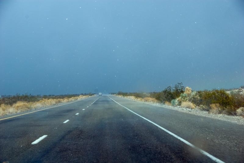The rain starts coming down quite heavily just ahead. The rain looks like SNOW!<br /> D200_2007-07-26DSC_3418-RoadRainstormLooksLikeSnow-2.JPG