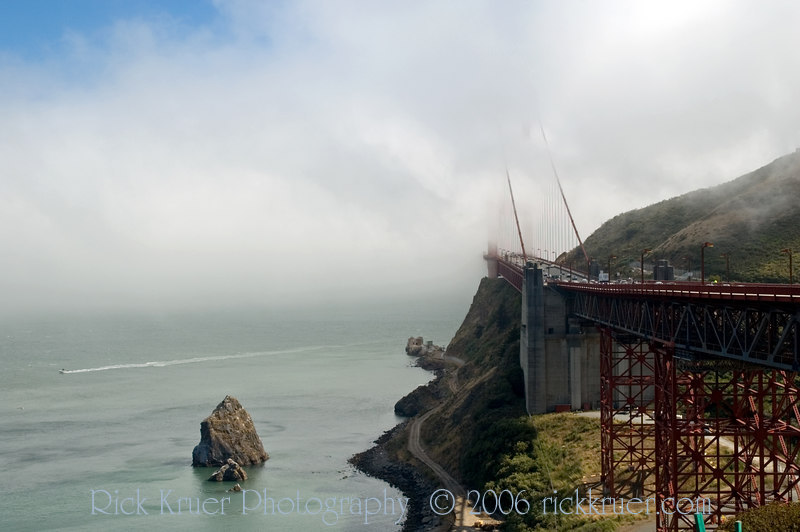 View of the fog from the Sausalito (north) side of the Golden Gate Bridge in San Fransisco, CA. We crossed the bridge in complete fog, most of the bridge was covered, except for the roadway.<br /> ND70_2006-07-09DSC_4285-GoldenGateFog-2.JPG