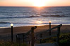 """An inviting view of the ocean on the Oregon Coast at sunset, looking through the Cavalier condo stairs to the beach. """"Come on down, the water's fine!""""<br /> <br /> ND70_2006-07-17DSC_5018-CavalierSunsetThroughStairway-3 copy.jpg"""