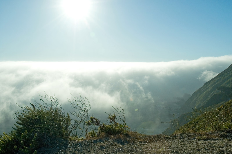 The sun is reflecting off the heavy fog over the ocean near Big Sur, CA. Note the rocks on the ocean coast below.<br /> ND70_2006-07-08DSC_4237-FogSun-2