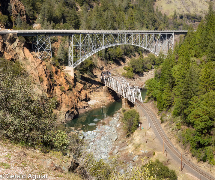 I had to scamper down the roadway to get this picture of these contrasting style of bridges.