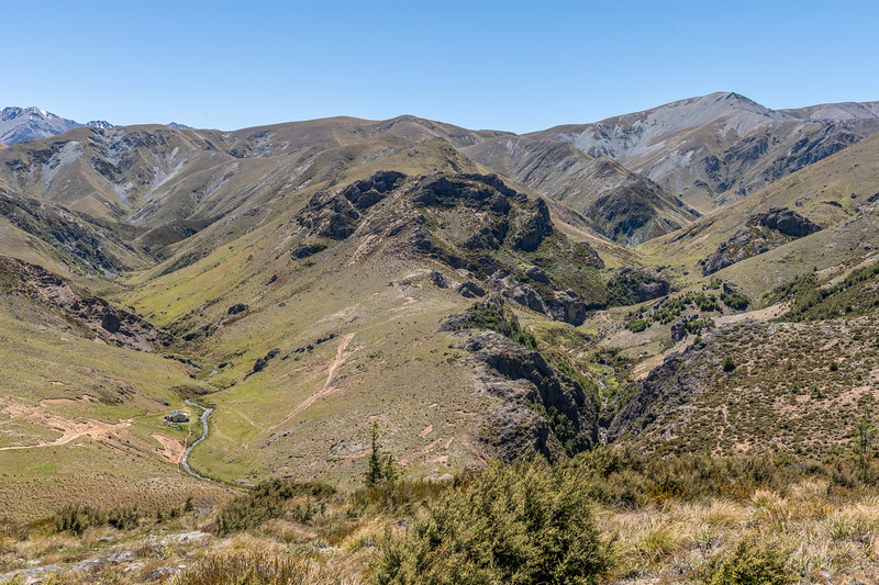 Woolshed Creek Hut. Woolshed Creek, Mt Somers. Peache Saddle and the Winterslow Range above.
