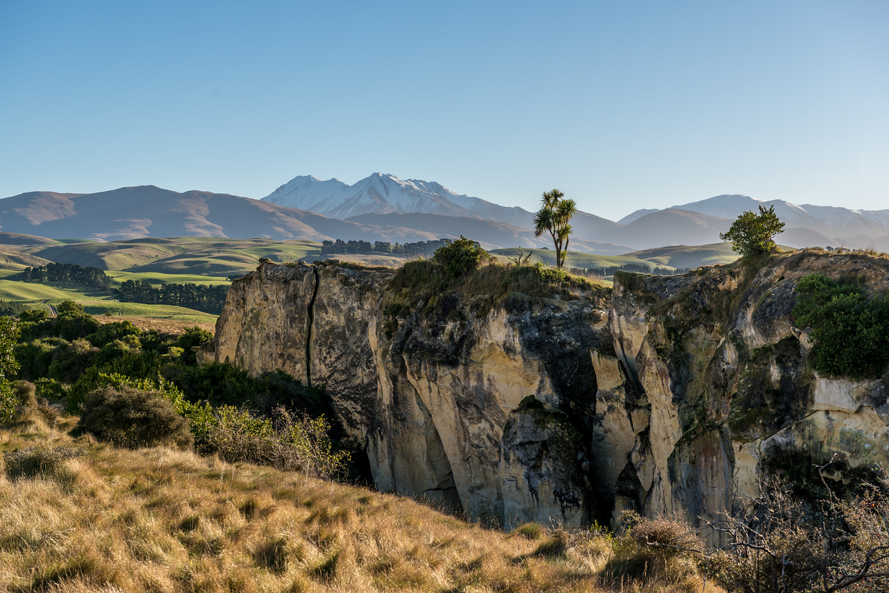 The limestone cliffs of Earthquakes, North Otago. Mount Domett and Little Domett in the background.
