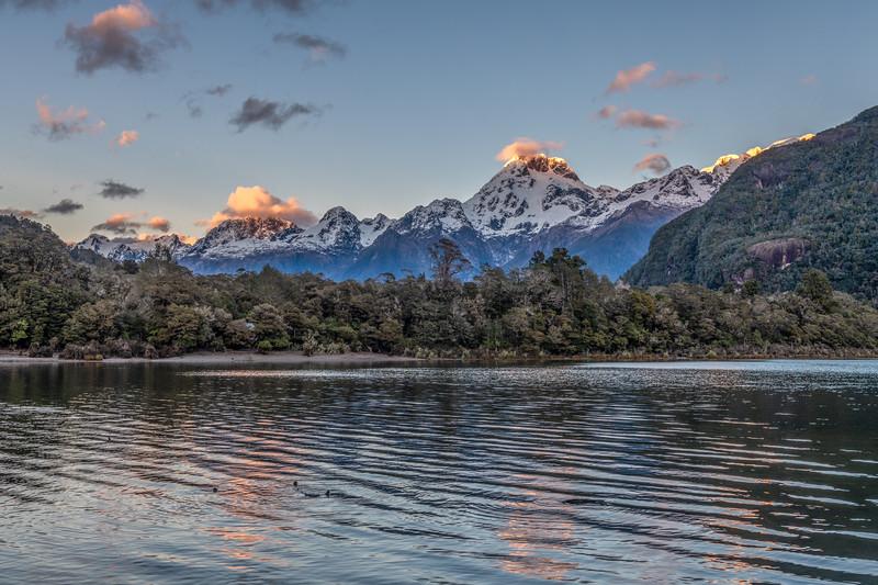 Lake Alabaster and Darran Mountains. From left to right are Mount Tuhawaiki, Taiaroa Peak, Mount Te Wera, Mount Madeline and Mount Tutoko.
