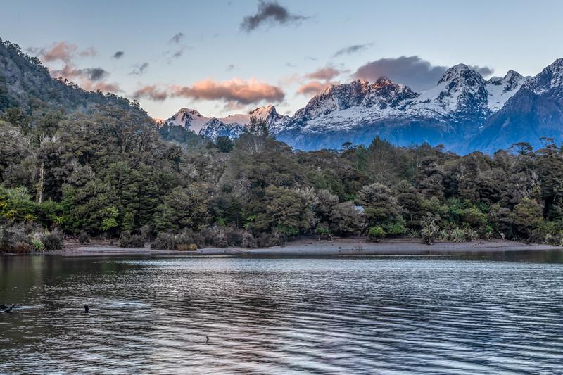 Lake Alabaster and Darran Mountains. From left to right are Mount Tuhawaiki, Taiaroa Peak and Mount Te Wera.