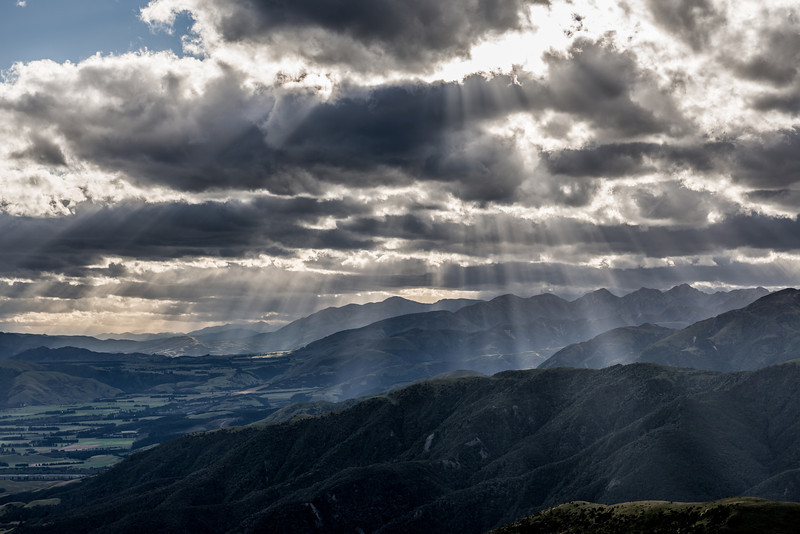 Sun rays filtered though cloud