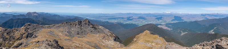Panorama from Mount Richmond, looking east. From left to right are Mount Fishtail, Te Koko-O-Kupe / Cloudy Bay, Johnston Peak (in the foreground), the Wairau River plains and the Inland Kaikoura Range. Richmond Range, Marlborough.