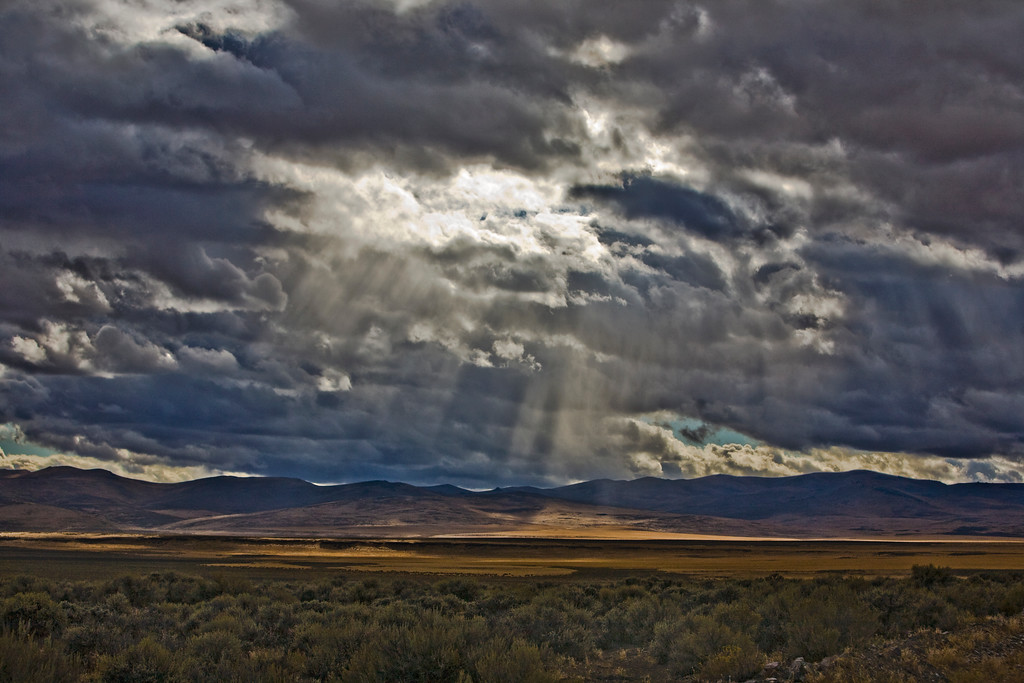 Light filtered through gathering clouds near Plush, Oregon