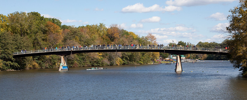 People lining the foot bridge over the Genesee River watching the boat race.