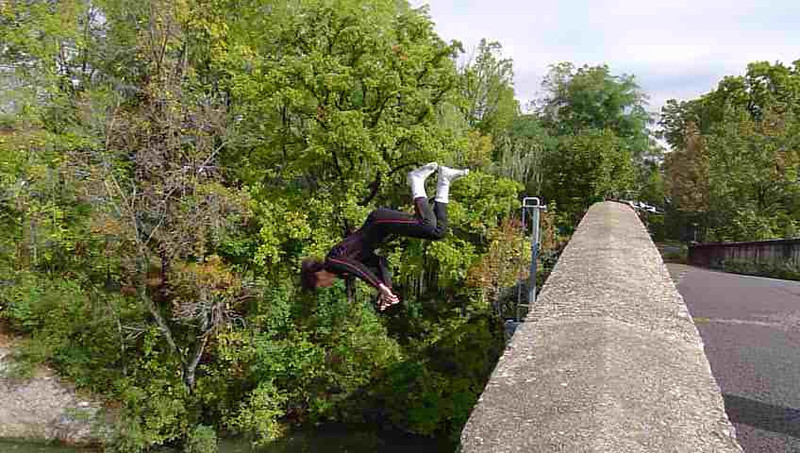 Two boys daring the bare shirted boy to jump into the canal. Jumping off bridge into the Erie Canal.