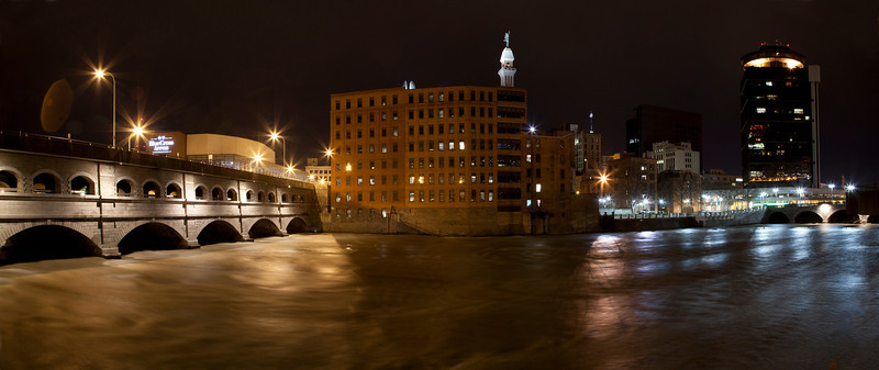 This is a panorama of the full Genesee River in springtime. Broad street on the left and Main street on the right.  Statue of Mercury dead center.