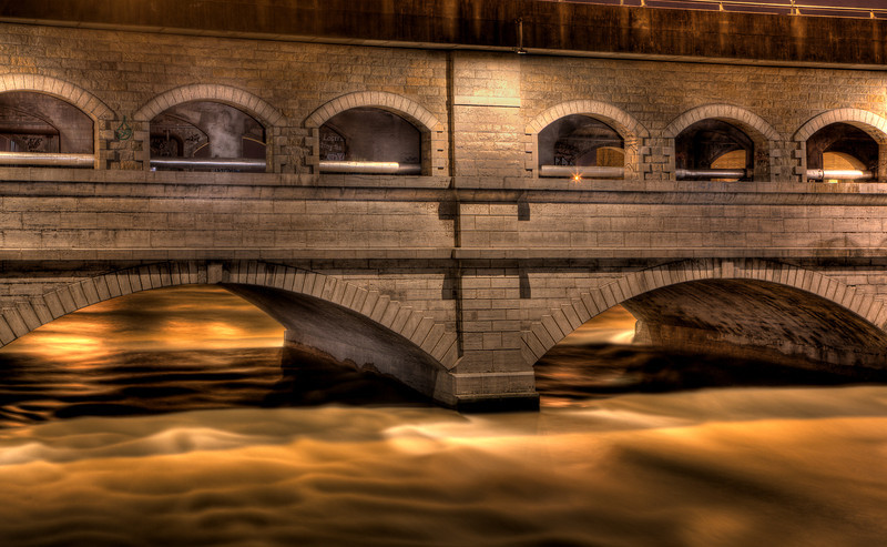 This a light painted HDR of the Broad Street subway.  The Genesee river is flowing quickly and the dark arches and dark subway  are light painted.