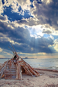 This is a log teepee house built out of driftwood on the shores of Lake Erie (Dunkirk, NY) by a single young man.